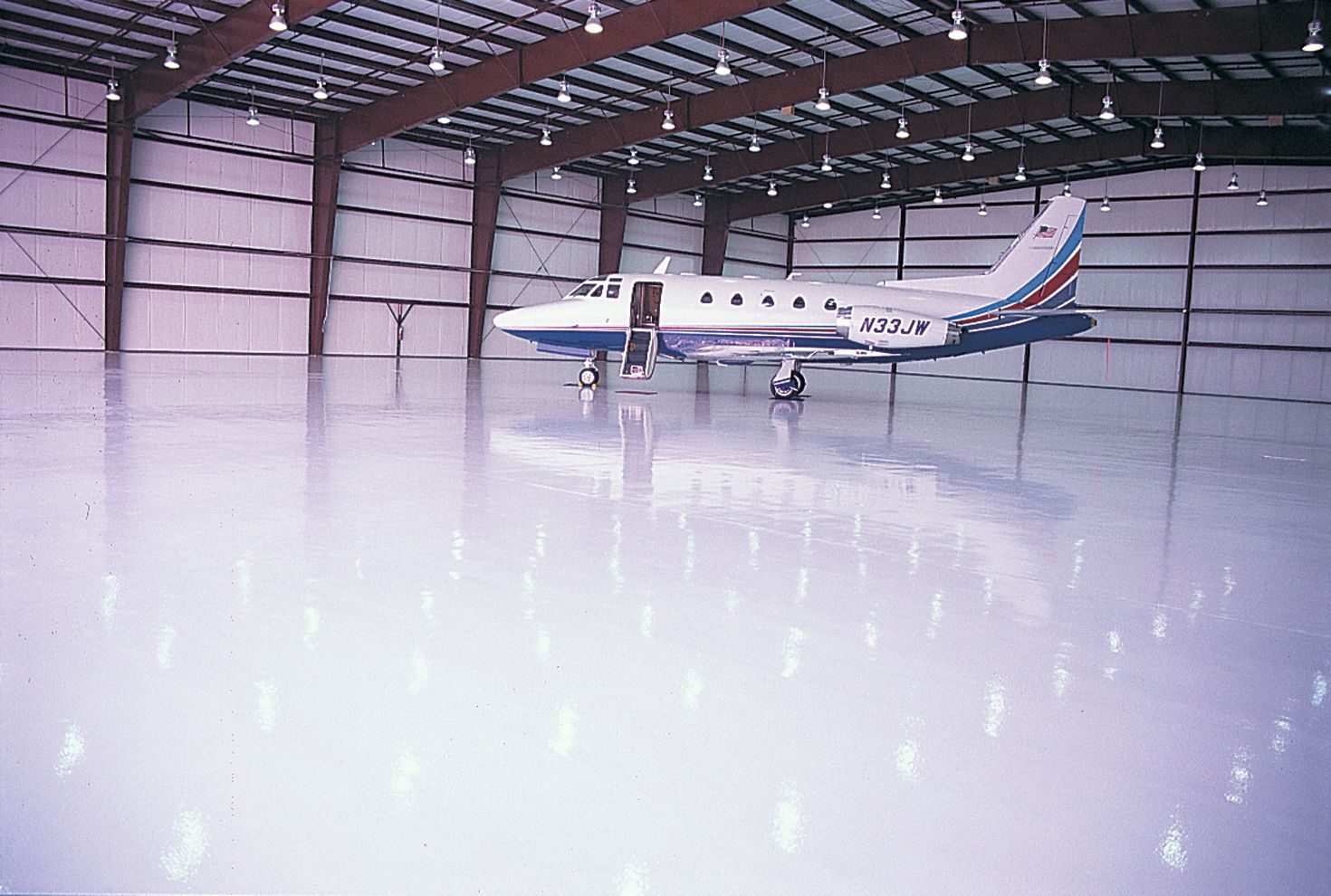 QuestMark's commercial epoxy floor coating applied in aircraft hangar