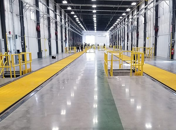 industrial polished concrete floors with green dyed line at loading dock