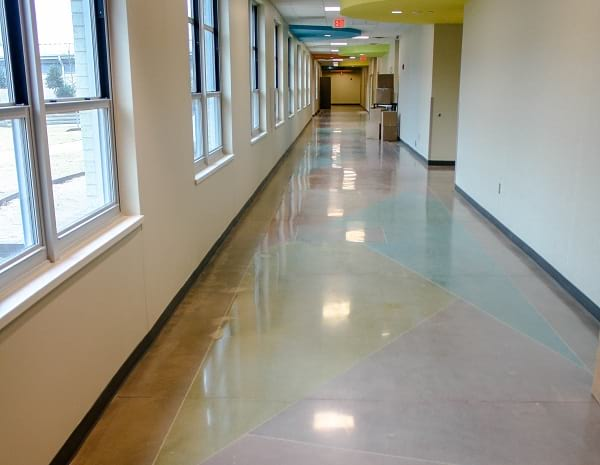 dyed decorative polished concrete flooring used in hallway of school