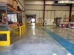 polished concrete floor with blue walkway in manufacturing facility