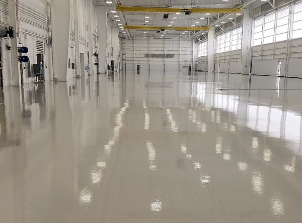 hangar with shiny gray epoxy coating on concrete floor