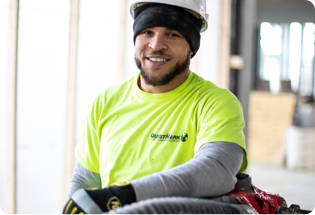 headshot of QuestMark employee with yellow shirt and hard hat