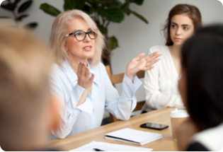 blonde woman talking in an administrative meeting