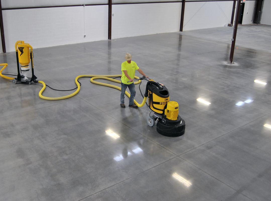 QuestMark employee operating concrete polishing machine
