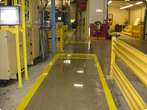 manufacturing facility with yellow safety striping on concrete floors